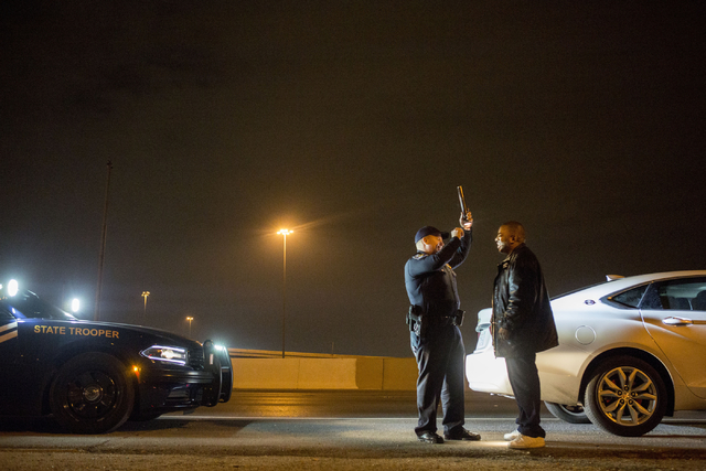 Nevada Highway Patrol trooper Ervin Raab, left, conducts a field sobriety test for a DUI suspect near the Spaghetti Bowl on Dec. 31, 2016. (Elizabeth Brumley/Las Vegas Review-Journal) @EliPagePhoto