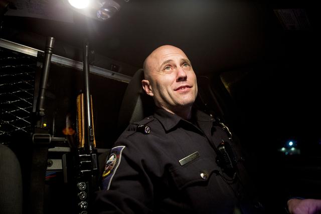Nevada Highway Patrol trooper Stoyan Georgiev runs a license plate while patrolling downtown Las Vegas early New Year's morning, Jan. 1, 2017. (Elizabeth Brumley/Las Vegas Review-Journal) @EliPage ...