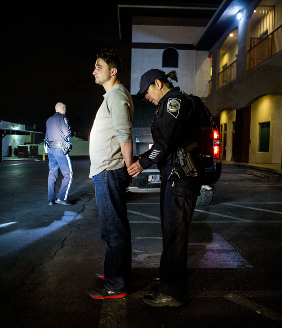 Nevada Highway Patrol trooper Angie Wolff arrests a DUI suspect in Las Vegas early on Jan. 1, 2017. (Elizabeth Brumley/Las Vegas Review-Journal) @EliPagePhoto