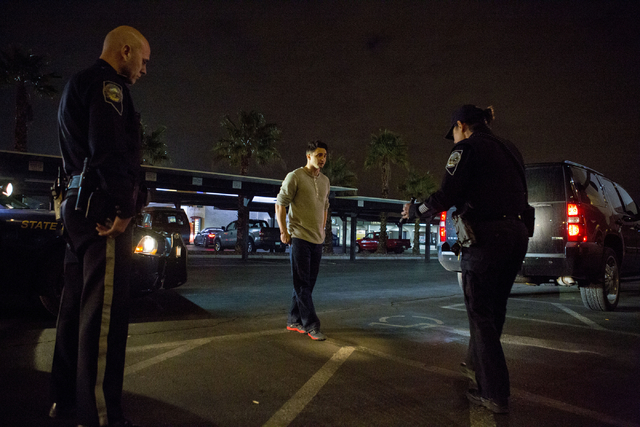 Nevada Highway Patrol troopers Stoyan Georgiev, left, and Angie Wolff, right, conduct a field sobriety test for a DUI suspect in Las Vegas early New Year's morning, Jan. 1, 2017. (Elizabeth Brumle ...