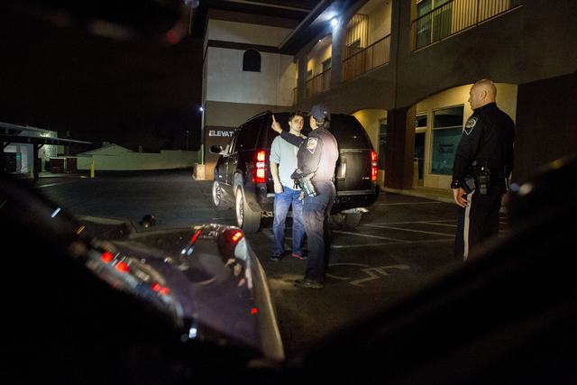 Nevada Highway Patrol troopers Angie Wolff, left, and Stoyan Georgiev, right, conduct a field sobriety test for a DUI suspect in Las Vegas early New Year's morning, Jan. 1, 2017. (Elizabeth Brumle ...