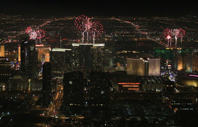 New Year's fireworks are set off on the Strip in Las Vegas on Sunday, Jan. 1, 2017, seen from a Sundance Helicopters tour. The company offers a bird's-eye view of festivities on the Strip. (Brett  ...