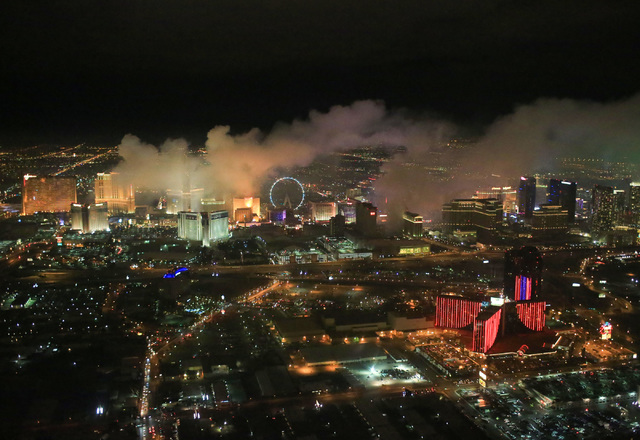 Smoke from New Year's fireworks hovers over the Strip in Las Vegas on Sunday, Jan. 1, 2017, seen from a Sundance Helicopters tour. The company offers a bird's-eye view of festivities on the Strip. ...
