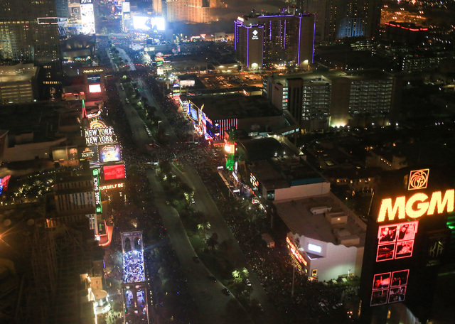 People pack the Strip for New Year's celebrations in Las Vegas on Sunday, Jan. 1, 2017, seen from a Sundance Helicopters tour. The company offers a bird's-eye view of festivities on the Strip. (Br ...