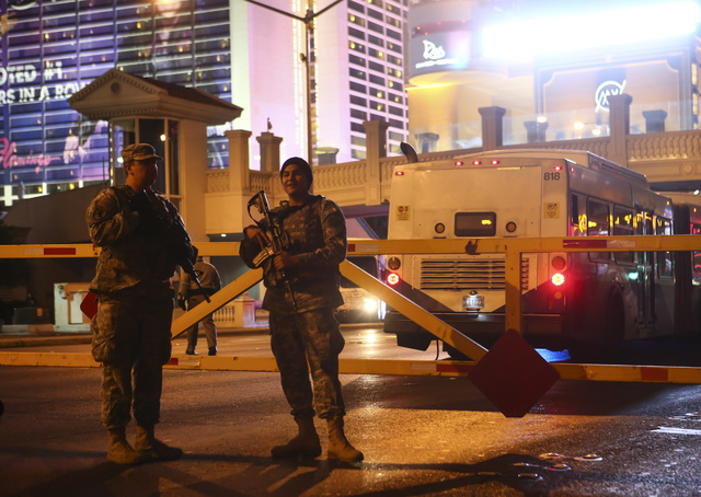 Members of the Nevada Army National Guard gather on the Las Vegas Strip on Saturday, Dec. 31, 2016. (Chase Stevens/Las Vegas Review-Journal) @csstevensphoto