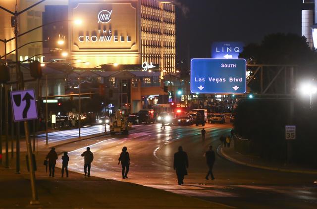 New Year's Eve revelers make their way along Flamingo Road to the Las Vegas Strip on Saturday, Dec. 31, 2016. (Chase Stevens/Las Vegas Review-Journal) @csstevensphoto