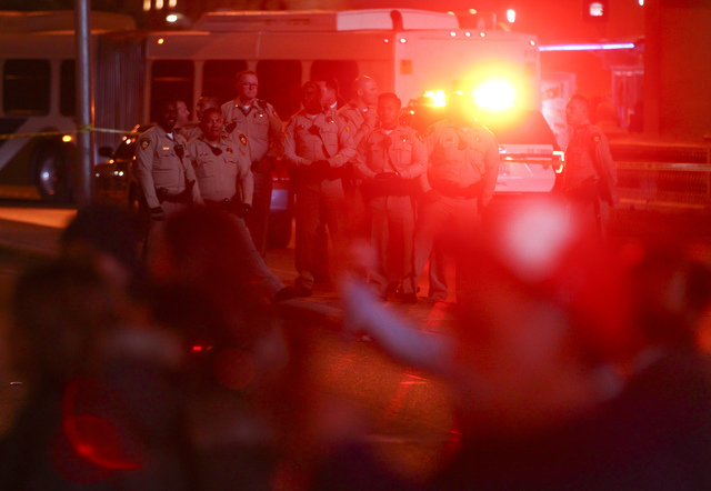 Las Vegas police officers watch as New Year's Eve revelers gather on the Strip on Saturday, Dec. 31, 2016. (Chase Stevens/Las Vegas Review-Journal) @csstevensphoto
