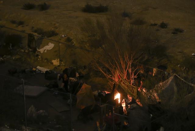 A bon fire burns at a homeless encampment near Interstate 15 off Flamingo Road in Las Vegas on Saturday, Dec. 31, 2016. (Chase Stevens/Las Vegas Review-Journal) @csstevensphoto
