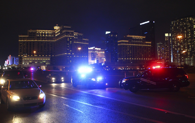 Law enforcement vehicles sit on Flamingo Road leading to  the Las Vegas Strip on Saturday, Dec. 31, 2016. (Chase Stevens/Las Vegas Review-Journal) @csstevensphoto