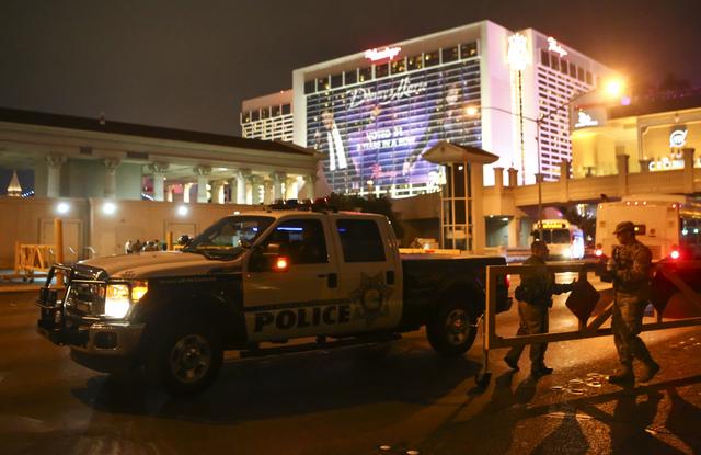Law enforcement officers gather on the Las Vegas Strip on Saturday, Dec. 31, 2016. (Chase Stevens/Las Vegas Review-Journal) @csstevensphoto
