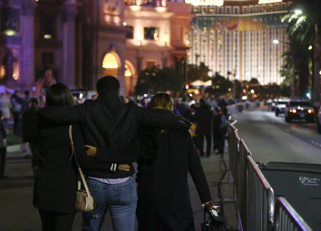 New Year's Eve revelers gather on the Las Vegas Strip outside of the Caesars Palace on Saturday, Dec. 31, 2016. (Chase Stevens/Las Vegas Review-Journal) @csstevensphoto
