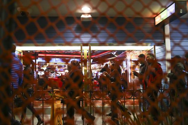 New Year's Eve revelers pass the Casino Royale hotel-casino on the Las Vegas Strip on Saturday, Dec. 31, 2016. (Chase Stevens/Las Vegas Review-Journal) @csstevensphoto