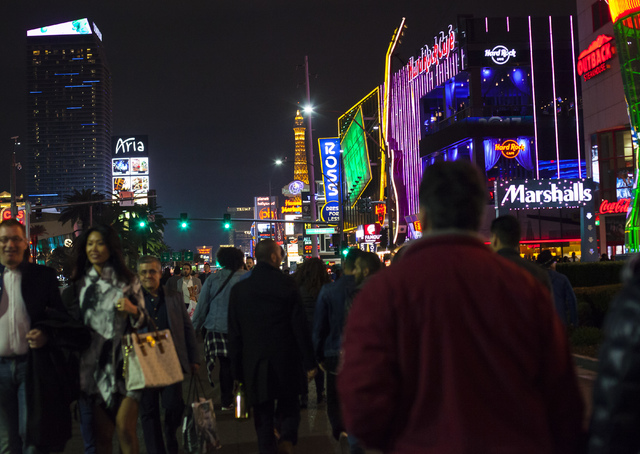 New Year's Eve revelers gather on the Las Vegas Strip on Saturday, Dec. 31, 2016. (Miranda Alam/Las Vegas Review-Journal) miranda.alam