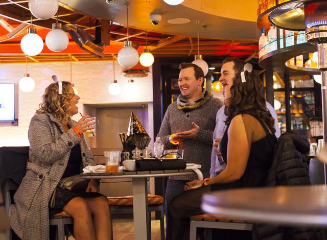 New Year's Eve revelers enjoy drinks at Tom's Urban on the Las Vegas Strip on Saturday, Dec. 31, 2016. (Miranda Alam/Las Vegas Review-Journal) miranda.alam