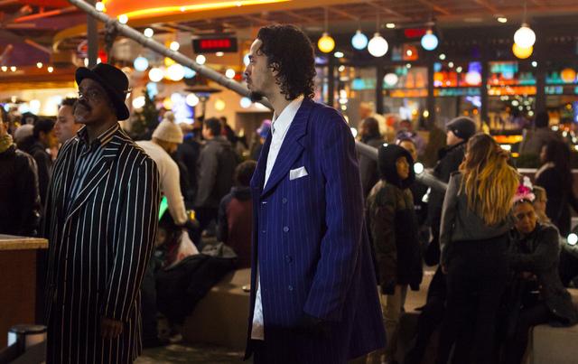 A man waits in line to buy beer outside of the New York-New York hotel-casino on the Las Vegas Strip on Saturday, Dec. 31, 2016. (Miranda Alam/Las Vegas Review-Journal) miranda.alam