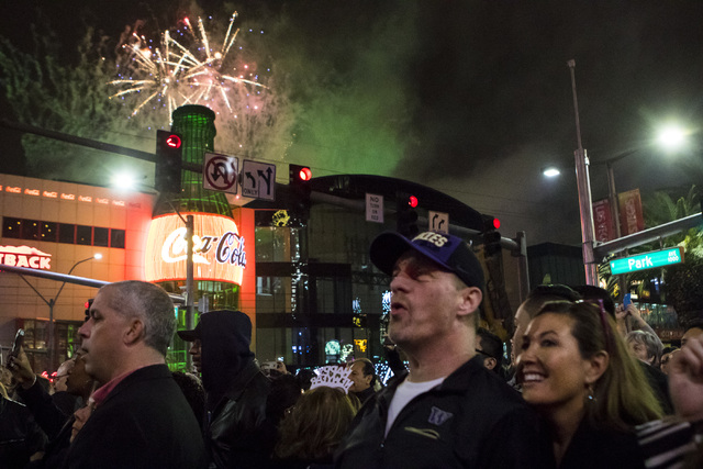 New Year's Eve revelers gather in front of The Park during the fireworks show on the Las Vegas Strip on Saturday, Dec. 31, 2016. (Miranda Alam/Las Vegas Review-Journal) miranda.alam