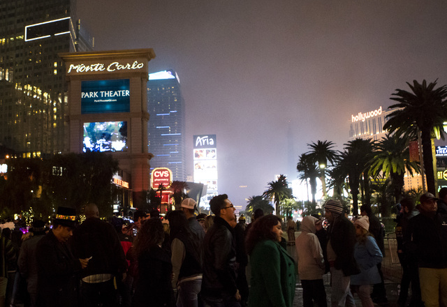 New Year's Eve revelers begin to exit the Las Vegas Strip after the fireworks show on Saturday, Dec. 31, 2016. (Miranda Alam/Las Vegas Review-Journal) miranda.alam
