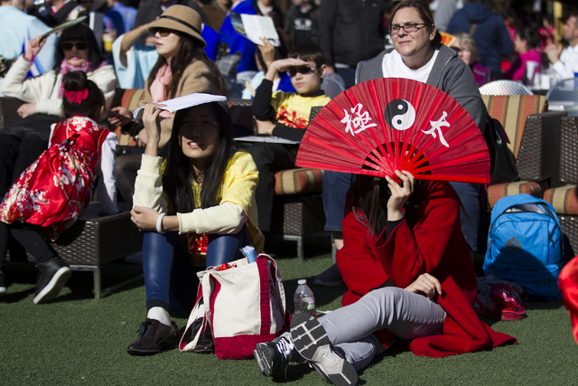Wang Lihan, left, and Xu Yan of Las Vegas watch a performance during the Chinese New Year in the Desert event at the Container Park on Saturday, Jan. 28, 2017, in Las Vegas. Erik Verduzco/Las Vega ...