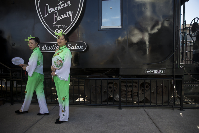 Suying Chen, left, and Fang Zhao, members of the Las Vegas Chinese Center Dance Troop, get ready to take perform in the Chinese New Year in the Desert event at the Container Park on Saturday, Jan. ...