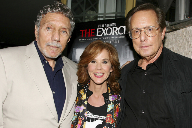 """In this Sept. 29, 2010 file photo released by Starpix, """"The Exorcist"""" author William Peter Blatty, left, joins Linda Blair, who starred in the 1973 film and William Friedkin, the film's director,  ..."""