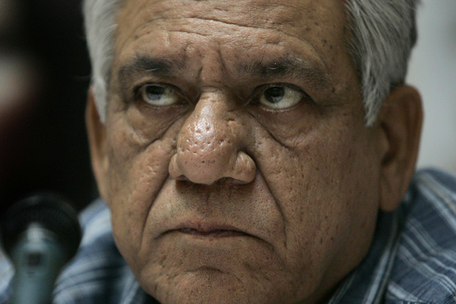 "In this July 22, 2008 photo, cast member of the film ""Shoot on Sight"", actor Om Puri attends a news conference at a hotel in central London to mark the film's UK release. (Joel Ryan/AP)"