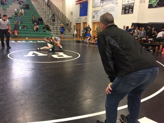 Coach Kevin Pine watches the action during a tournament Dec. 21, 2016, at Palo Verde High School. He coaches 40 members on the Palo Verde team. Only four are girls, but he said it's a gaining in ...