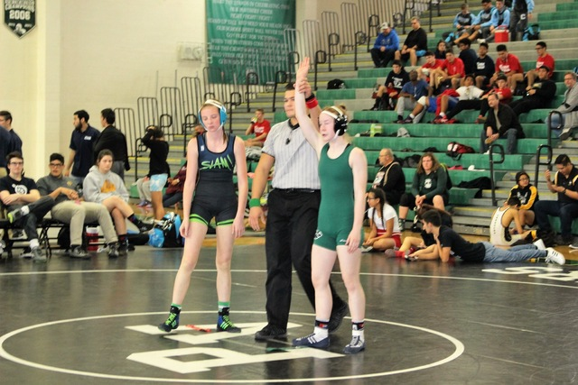Morgan Mackey (left) of SLAM Academy is seen is seen Dec. 21, 2016 after a match with Tatum Pine (Palo Verde team) at Palo Verde's gym. The event was a tournament that saw 45 wrestlers compete f ...
