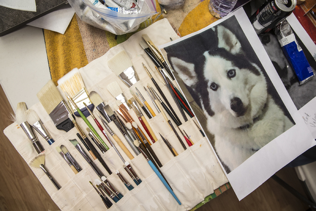 Artist Libby Chan painted her son's Siberian husky at Thursday's pet portrait workshop. At previous pet portrait workshops, she has painted her own dog as well as family members'. (Benjamin Hager/ ...