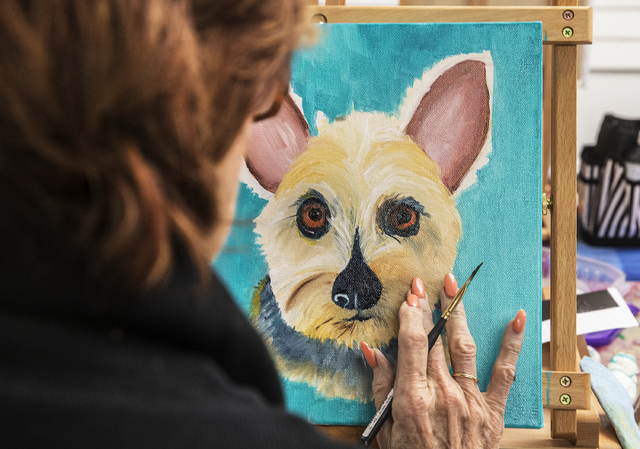 Artist Judi Moreo finalizes a painting of her terrier, Sweet Pea, during a pet portrait class Thursday. (Benjamin Hager/Las Vegas Review-Journal)