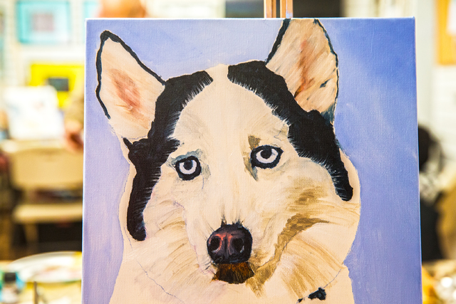 Artist Libby Chan painted her son's Siberian husky during Thursday's pet portrait workshop. (Benjamin Hager/Las Vegas Review-Journal)