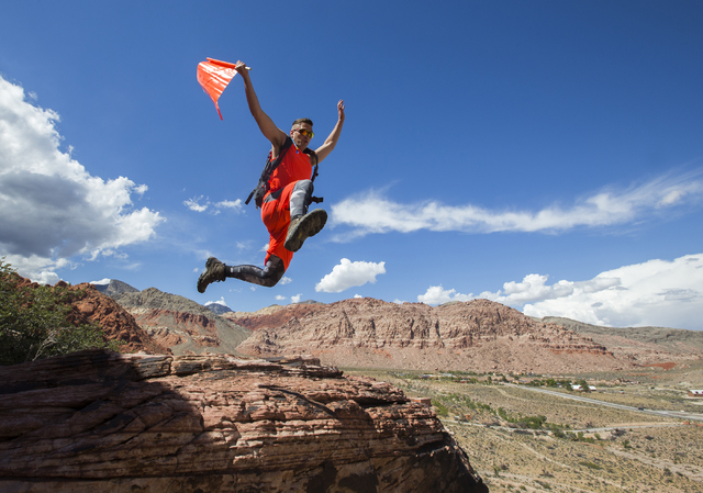 Flyn Cooley, co-founder of Kazoom Adventures, leaps from one rock formation to another at Red Rock Canyon National Conservation Area, near Las Vegas. Kazoom Adventures combines elements of geocach ...