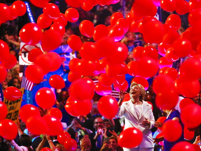 Democratic presidential nominee Hillary Clinton walks off the stage through a sea of balloons during the final day of the Democratic National Convention at the Wells Fargo Center on Thursday, July ...