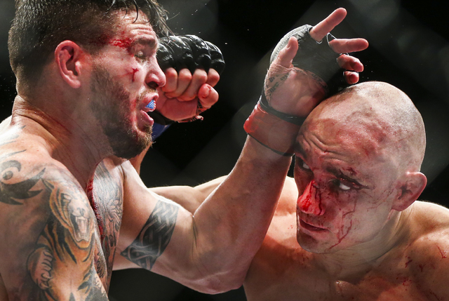 Chris Camozzi, left, fights Vitor Miranda in their middleweight bout during UFC Fight Night 88 at Mandalay Bay Events Center in Las Vegas on Sunday, May 29, 2016. Camozzi won by unanimous decision ...