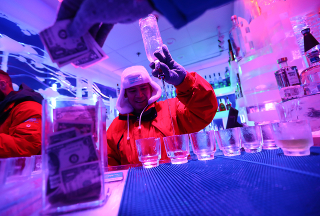 Arturo Alipio prepares drinks at the Minus5 Ice Bar, which maintains a temperature of 23 degrees Fahrenheit, at Shoppes at Mandalay Place in Las Vegas on Wednesday, Feb. 24, 2016. Chase Stevens/La ...