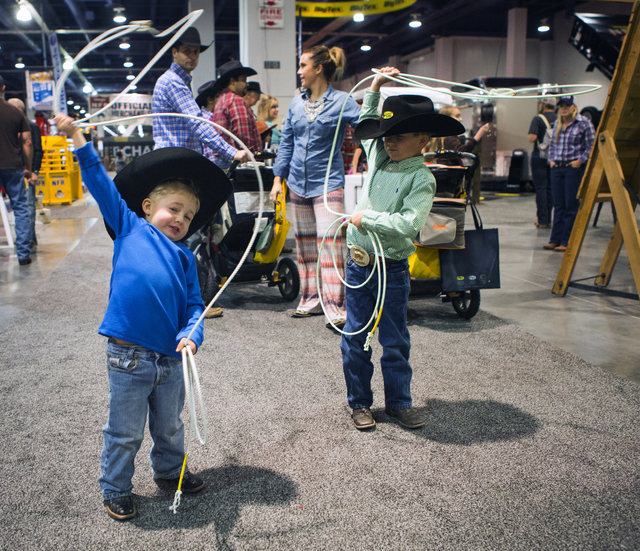Macoy Shoneberg,left, 3, and his brother Hadley, 6, twirls ropes during the first day of Cowboy Christmas at the Las Vegas Convention Center on Thursday, Dec. 1, 2016. Over 400 vendors are showcas ...
