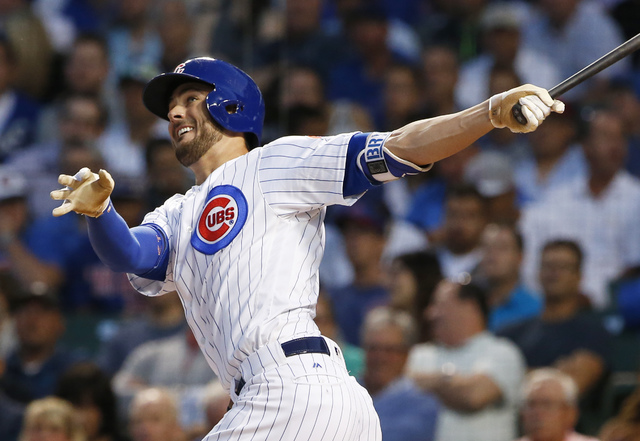 Chicago Cubs' Kris Bryant follows through on a solo home run during the first inning against the Pittsburgh Pirates in Chicago, Aug. 31, 2016.  (Nam Y. Huh/AP)