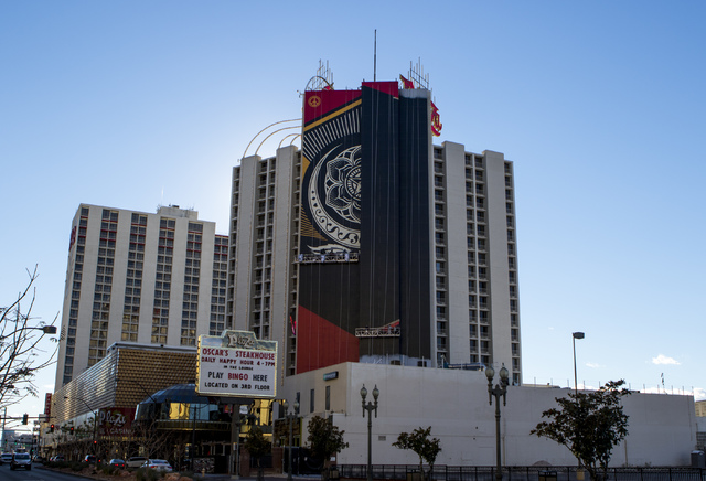 A Shepard Fairey mural goes up on the side of The Plaza hotel-casino in downtown Las Vegas on Wednesday, Jan. 25, 2017. (Miranda Alam/Las Vegas Review-Journal) @miranda_alam