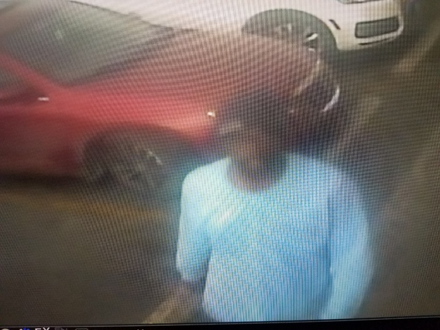 The suspect is described by police as a black man with a goatee, who was last seen wearing black-framed glasses and a blue long-sleeved shirt with a logo. He drove away in a newer-model maroon Chr ...
