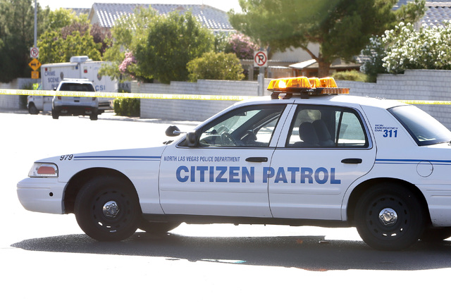 A VIPS Citizen's Patrol Program vehicle blocks the street where an officer shot a robbery suspect near Tropical Parkway and Clayton Street in September 2014. In North Las Vegas, VIPS Citizen's ...