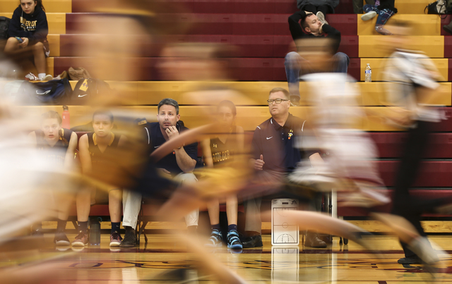 Boulder City girls basketball coach Paul Dosch, center right, during a basketball game at Del Sol High School in Las Vegas on Tuesday, Jan. 10, 2017. Dosch, 44, who has been coaching the team for  ...