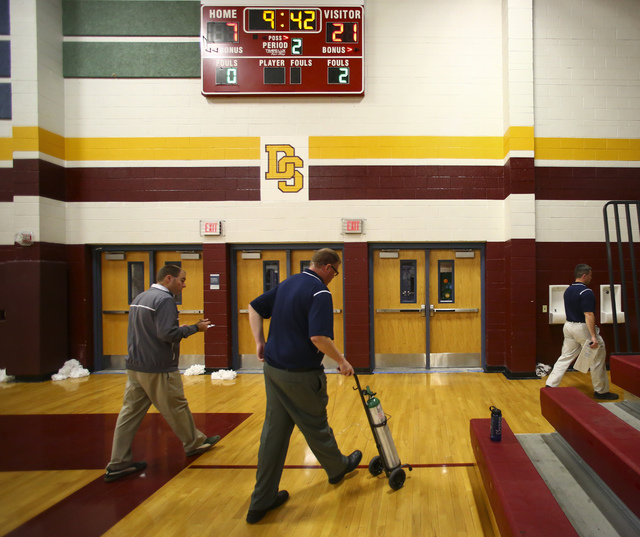 Boulder City girls basketball coach Paul Dosch walks off the court at halftime during a basketball game at Del Sol High School in Las Vegas on Tuesday, Jan. 10, 2017. Dosch, 44, who has been coach ...