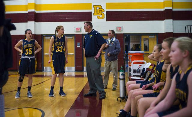 Boulder City girls basketball coach Paul Dosch talks with player Ellie Howard (33) before the start of a basketball game at Del Sol High School in Las Vegas on Tuesday, Jan. 10, 2017. Dosch, 44, w ...