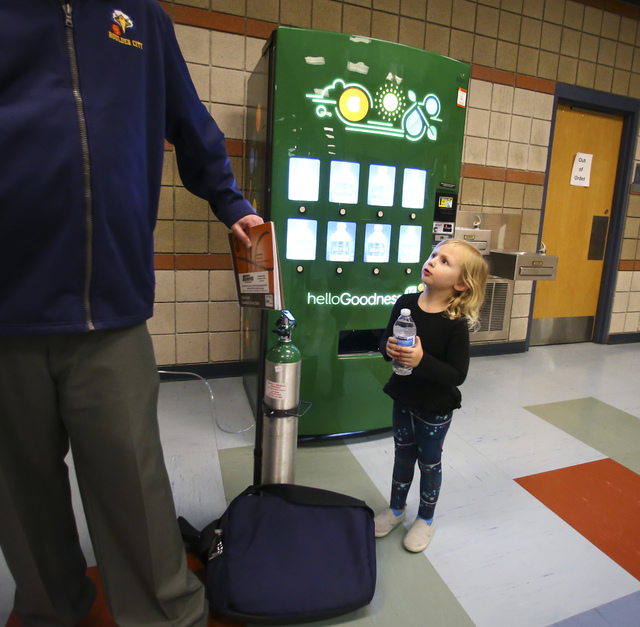 Harper Dosch, 4, looks up at her father, Paul, coach of the Boulder City girls basketball team, after a game at Del Sol High School in Las Vegas on Tuesday, Jan. 10, 2017. Dosch, 44, who has been  ...
