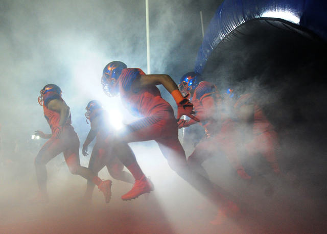 Bishop Gorman players take the field before the start of their prep football game against St. Thomas Aquinas Fla. at Bishop Gorman High School in Las Vegas Friday, Sept. 30, 2016. (Josh Holmberg/L ...