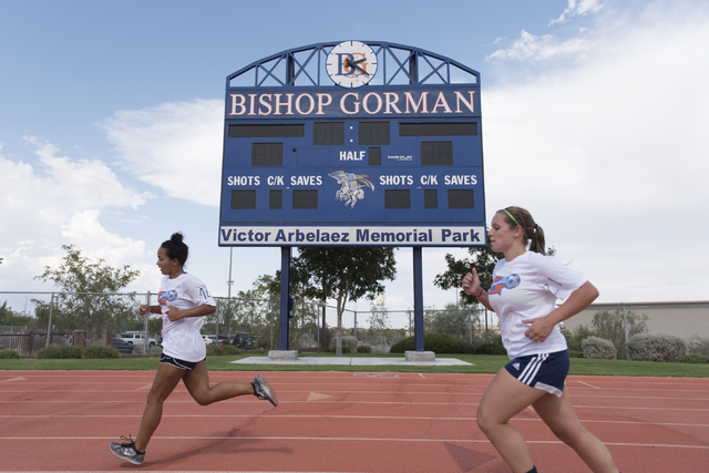 Members of the girls soccer teams run around the track during practice at Bishop Gorman High School in Las Vegas Thursday, Aug. 18, 2016. (Jason Ogulnik/Las Vegas Review-Journal)
