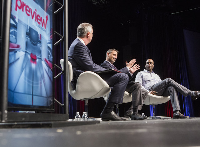 Steve Hill, left, director of Nevada Governor's Office of Economic Development moderates a panel with Brian Gaumer, director of Test & Development, HyperloopOne, and Marcelina Ford, general ma ...