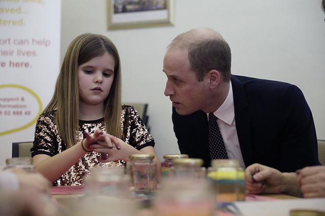 Britain's Prince William speaks with Aoife, 9, during his visit to a Child Bereavement in east London, Wednesday, Jan. 11, 2017. (Matt Dunham/AP)