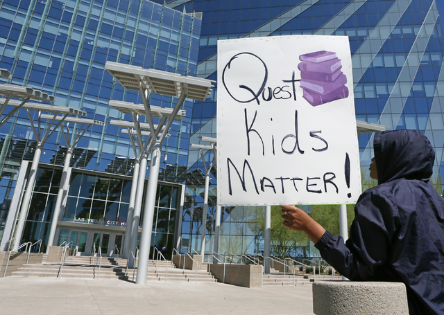 Freshman Madison Perkins holds a sign during a Quest Academy rally involving students, parents and community members outside City Hall Wednesday, March 23, 2016, in Las Vegas. The Dr. Roberson Cam ...