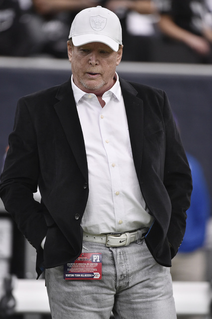 Raiders owner Mark Davis watches teams warm up before the first half of an AFC Wild Card NFL game between the Houston Texans and the Oakland Raiders, Saturday, Jan. 7, 2017, in Houston. (AP Photo/ ...