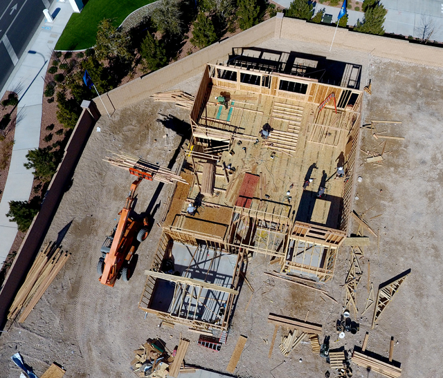 Aerial view of a construction crew working to complete a home in the Skye Canyon housing development in northwest Las Vegas on Wednesday, January 26, 2017. (Michael Quine/Las Vegas Review-Journal) ...